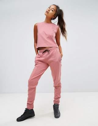 Reebok Classics Tapered Sweat Pants In Pink