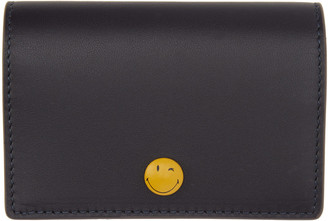 Anya Hindmarch Navy Wink Popper Folded Card Holder $245 thestylecure.com