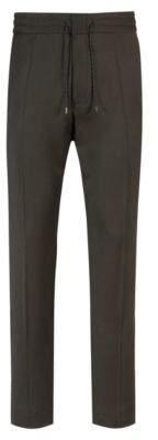 HUGO Boss Tapered-fit stretch-virgin-wool pants elastic waist 30R Dark Green