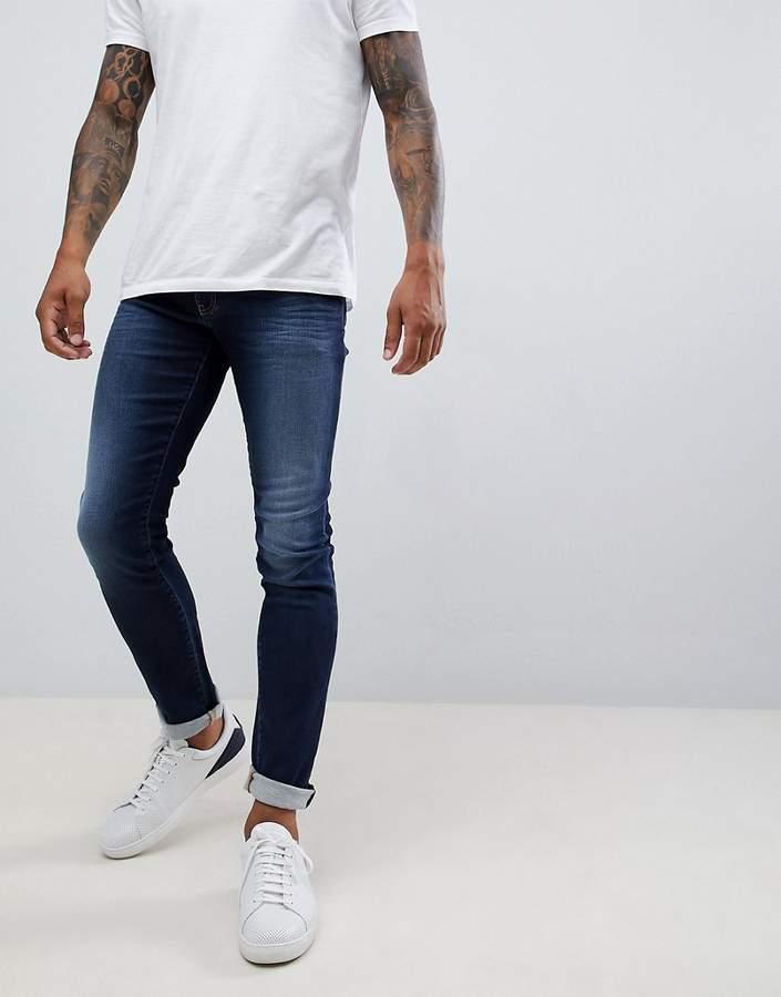 Armani Exchange J14 skinny fit 5 pocket stretch jeans in mid wash