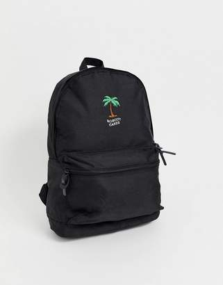 Asos (エイソス) - Asos Design ASOS DESIGN backpack in black with nobody cares print and palm tree
