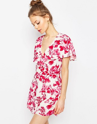 Asos Ruffle Wrap Playsuit In Floral Print