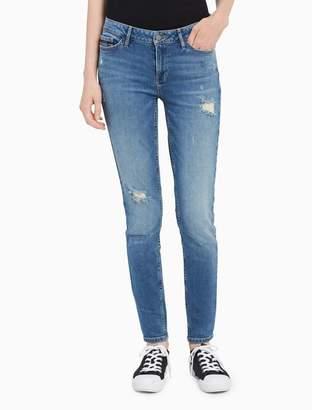 Calvin Klein blue distressed leggings