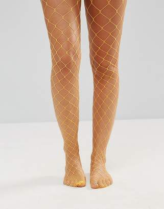 Asos DESIGN Oversized Fishnet Tights in Orange