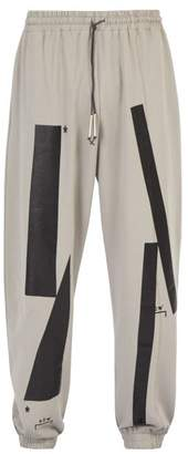 A-Cold-Wall* A Cold Wall* Plastisol Printed Cotton Jersey Track Pants - Mens - Beige