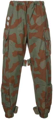 Off-White camouflage print trousers