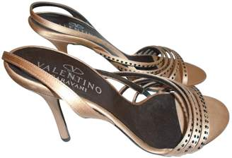 Valentino Gold Cloth Sandals