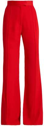 KHAITE Harriet wide-leg flared crepe trousers