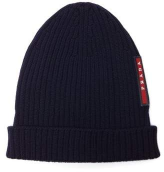 Prada - Logo Embellished Ribbed Knit Beanie Hat - Mens - Navy