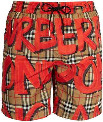 Burberry Graffiti and check-print swim shorts