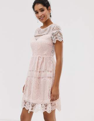 Liquorish lace overlay mini dress with open back detail