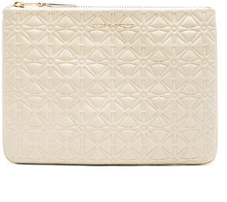 Comme des Garcons Star Embossed Pouch in Off White | FWRD