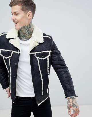 Asos DESIGN western faux shearling jacket in black