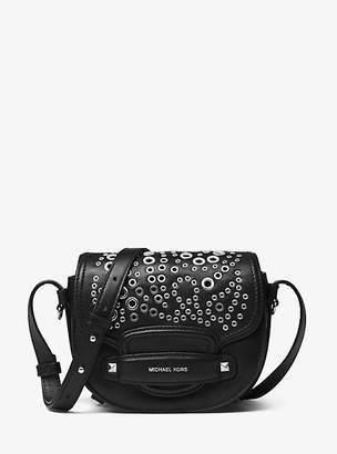 At Michael Kors Cary Small Grommeted Leather Saddle Bag