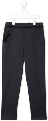 Familiar ribbon tapered trousers