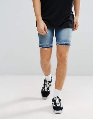 Asos DESIGN Denim Shorts In Skinny Mid Wash Blue With Cut And Sew Detail