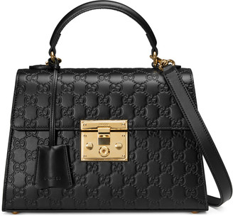 Padlock Gucci Signature top handle bag $2,290 thestylecure.com