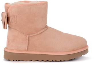 UGG Mini Bailey Bow Pink Sheepskin Ankle Boots With Satin Bow.