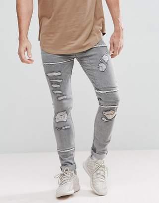 Asos DESIGN Super Skinny Jeans In Gray With Rip And Repair