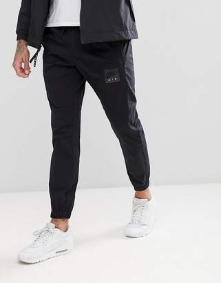 Nike Skinny Fit Woven Joggers In Black 886054-010