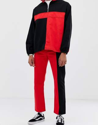 Collusion COLLUSION colour blocked straight leg jeans in black and red