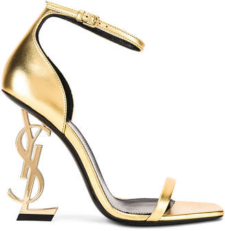 Saint Laurent Logo Ankle Strap Heel in Gold | FWRD
