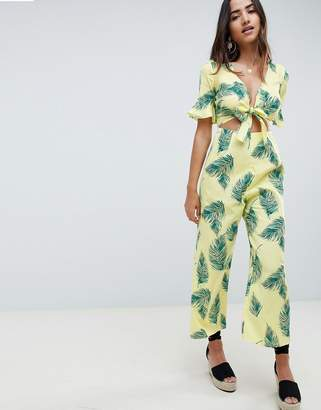 Asos DESIGN tea jumpsuit with cut out and tie detail in linen in leaf print