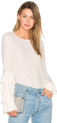 Norma Kamali x REVOLVE Ruffle Tee in White in White $245 thestylecure.com