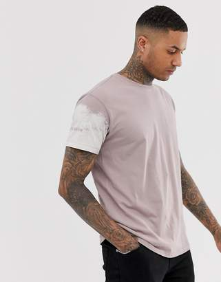 Religion loose fit t-shirt with bleach arm print in dusty pink
