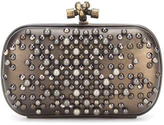 ... Bottega Veneta Embellished Knot leather clutch 31de1808b244a