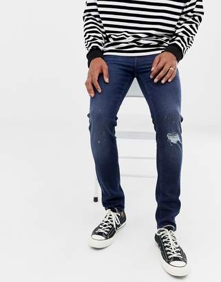 Asos DESIGN 14oz skinny heavy weight jeans in dark wash with knee rips