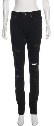 Saint Laurent Distressed Mid-Rise Jeans