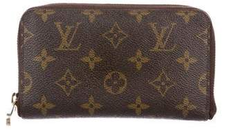 Louis Vuitton Monogram Vertical Zippy Compact Wallet