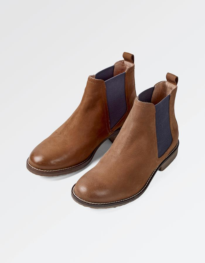 Outer Material: Leather Inner Material: Leather Sole: Gum Rubber Closure: Zip Heel Height: 3 centimetres Heel Type: Western Heel Shaft Diameter: Regular.