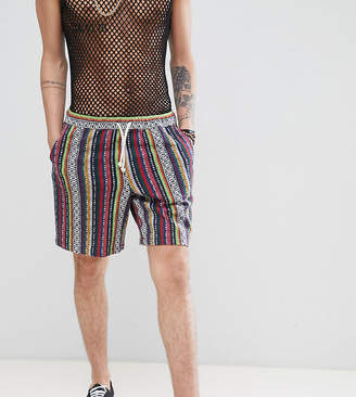 Asos DESIGN Tall festival slim shorts with elasticated waistband in geo-tribal stripe