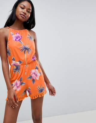 Asos DESIGN jersey halter neck romper with tassel hem in floral print