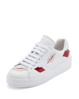 Prada Lip-Appliqué Lace-Up Low-Top Sneaker, White $750 thestylecure.com