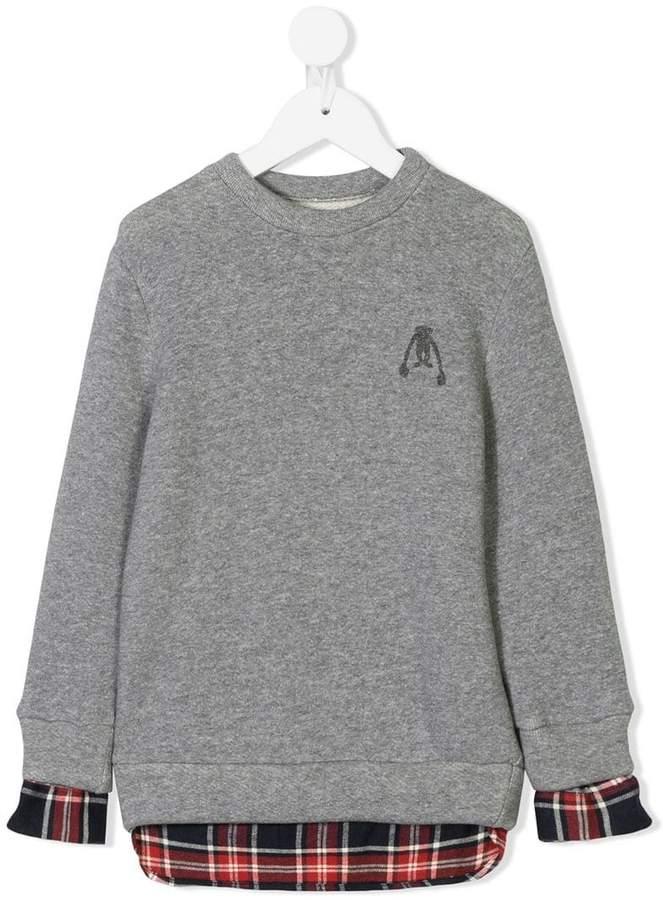 Touriste plaid shirt insert sweater