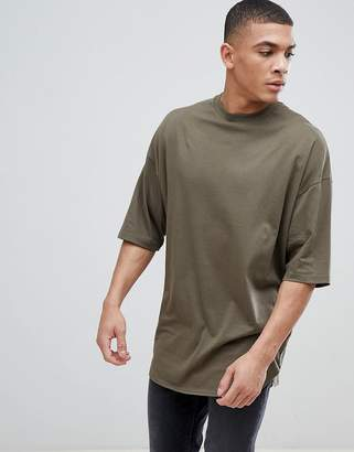Asos DESIGN oversized longline t-shirt with deep curve hem in green