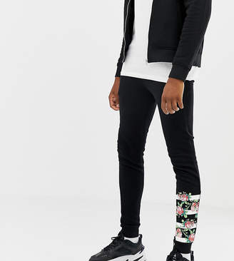 Asos Design DESIGN Tall super skinny joggers with rose gold zip pockets and print