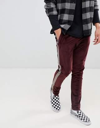 Asos DESIGN Skinny Burgundy Velour Pants With Side Stripe