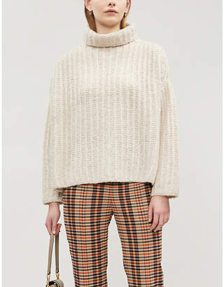 Free People Fluffy Fox ribbed-knit turtleneck jumper