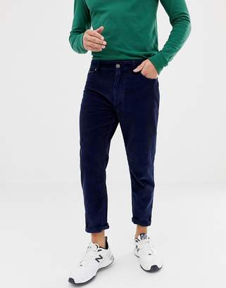Tommy Jeans tapered ankle length heavy corduroy pants in navy