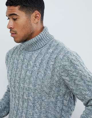 Asos DESIGN heavyweight cable knit roll neck sweater in blue twist