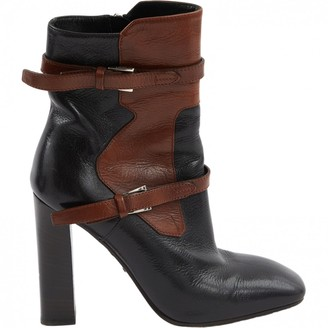 Prada Leather buckled boots