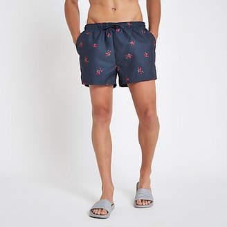 River Island Navy rose print swim trunks