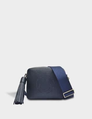 Anya Hindmarch Smiley Crossbody Bag in Navy Sugar Leather