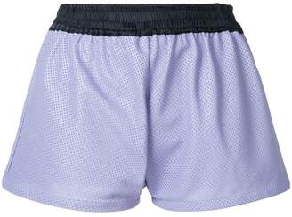 Coup De Coeur perforated shorts