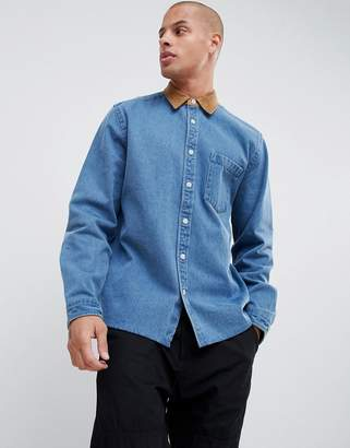 Asos DESIGN overshirt in heavy denim with cord collar and cuffs in mid wash