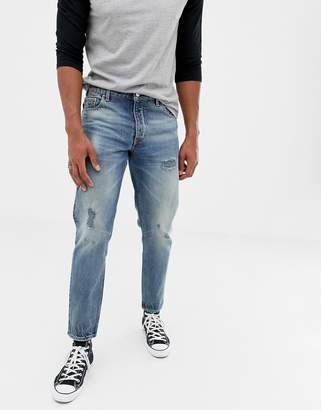 Asos DESIGN 14oz heavy weight tapered jeans in mid wash blue with rips